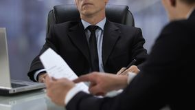 Male director listening to talking partner, work meeting, ignoring colleague stock video footage