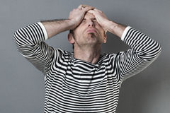 Male disaster concept for shocked middle age man Stock Photos