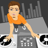 Male disc jockey mixing the track using his turntables Stock Image