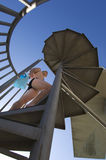 Male Diver Climbing Up The Stairs Royalty Free Stock Image