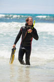 Male diver with diving suit snorkel mask fins on the beach. In Summer Royalty Free Stock Photo