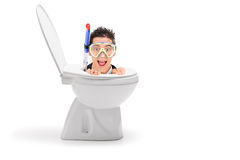 Male diver stuck in a toilet bowl Royalty Free Stock Photography