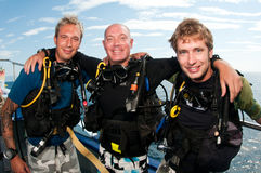 Male divers scuba dive together Stock Photography