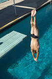 Male Diving Upside Down. Caucasian male swimmer diving upside down into the pool Stock Photography