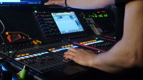 Male dj adjusting controls at mixing console in nightclub. DJ mixer player. DJ at sound console. shot of professional. Musician hands, people create music on stock footage