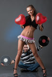 Male DJ and beautiful girl Royalty Free Stock Photos