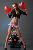 Male DJ and beautiful girl Stock Image
