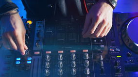 Male dj behind the turntables. stock footage