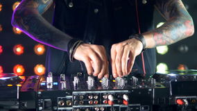 Male dj hands playing music, standing behind the turntables. stock footage