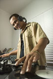 Male DJ with hands on record. Royalty Free Stock Image