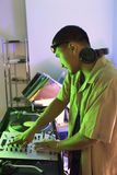 Male DJ with hands on turntable. Stock Photos
