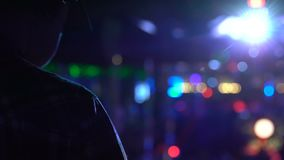 Male dj in headphones working in club lights, party atmosphere, entertainment. Stock footage stock footage