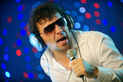 Male DJ with microphone. Horizontal image of male DJ with microphone Stock Images