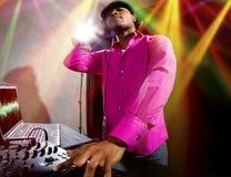 Male DJ playing Electronic Music Stock Photo