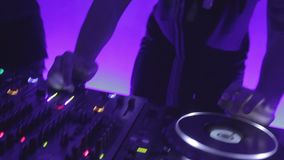 Male dj scratching platter on turntable during performance in popular night club. Stock footage stock footage