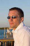 Male dockside sunset portrait. Male model watching a sunset looking out over a Florida marina Royalty Free Stock Photos