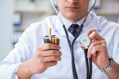The male doctor in anti-smoking conceptwithcigarette pack Stock Photography