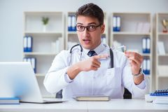 The male doctor in anti-smoking conceptwithcigarette pack Royalty Free Stock Images