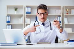 The male doctor in anti-smoking conceptwithcigarette pack Royalty Free Stock Photo