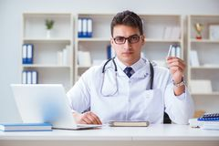 The male doctor in anti-smoking conceptwithcigarette pack Royalty Free Stock Photography