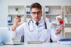 The male doctor in anti-smoking conceptwithcigarette pack Stock Images