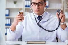 The male doctor in anti-smoking conceptwithcigarette pack Stock Photo