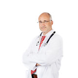 Male Doctor With Arms Crossed Against White Background Stock Photos