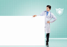 Male doctor with banner Stock Photo