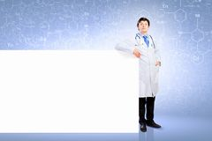 Male doctor with banner Royalty Free Stock Images