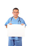 Male doctor with blank placard. Friendly male doctor in blue scrubs, holding the blank placard Stock Photos