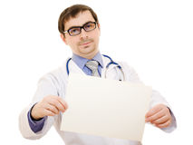Male doctor with a blank sheet of paper Stock Images