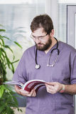 Male doctor with a book Stock Photography