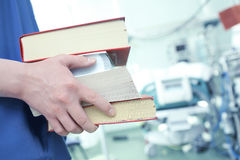 Male doctor with books in ICU Stock Photo