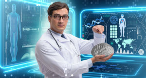 The male doctor with the brain in medical concept Royalty Free Stock Images
