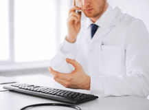 Male doctor with capsules Royalty Free Stock Image