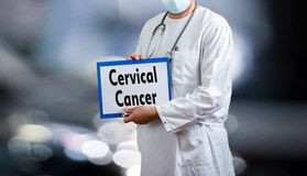 Male doctor cervical cancer. A male doctor in uniform with mask and gloves Royalty Free Stock Photos