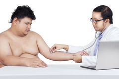 Male doctor checking heartbeat person Royalty Free Stock Photo