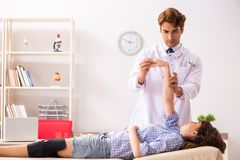 Male doctor checking joint flexibility with goniometer stock photography