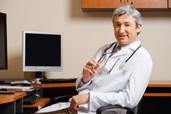 Male Doctor In Clinic Stock Photo