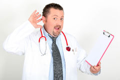Male doctor with clipboard Royalty Free Stock Images