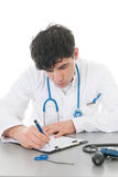 Male doctor with clipboard Royalty Free Stock Photography