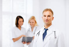 Male doctor with colleagues Royalty Free Stock Images