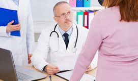 Male doctor consulting woman at his office, healthcare and medical concept, copy space royalty free stock photo