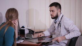 Male doctor consults his patient in the office. stock video