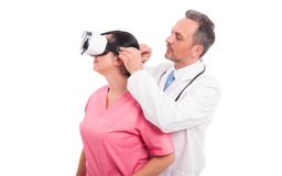 Male doctor convince nurse to wear vr glasses. As reality simulation concept isolated on white background Royalty Free Stock Photos