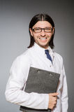 The male doctor with diary against gray Royalty Free Stock Image
