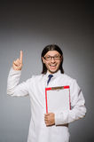 The male doctor with diary against gray Royalty Free Stock Photography