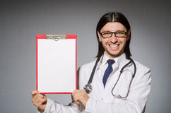 Male doctor with diary against gray Stock Photography