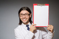 The male doctor with diary against gray Stock Images