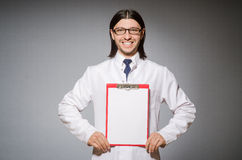 The male doctor with diary against gray Stock Photo